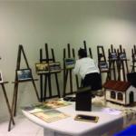 Visitante confere exposição de fotos de São Martinho